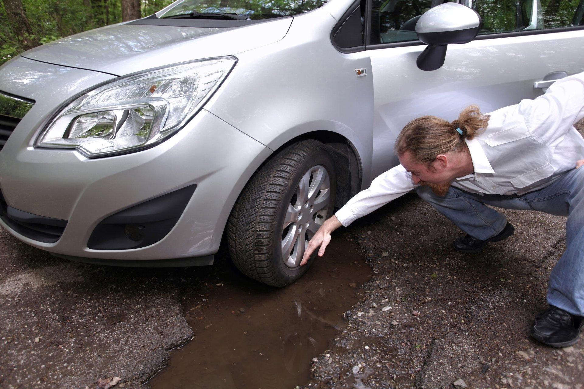 Upset driver near pothole