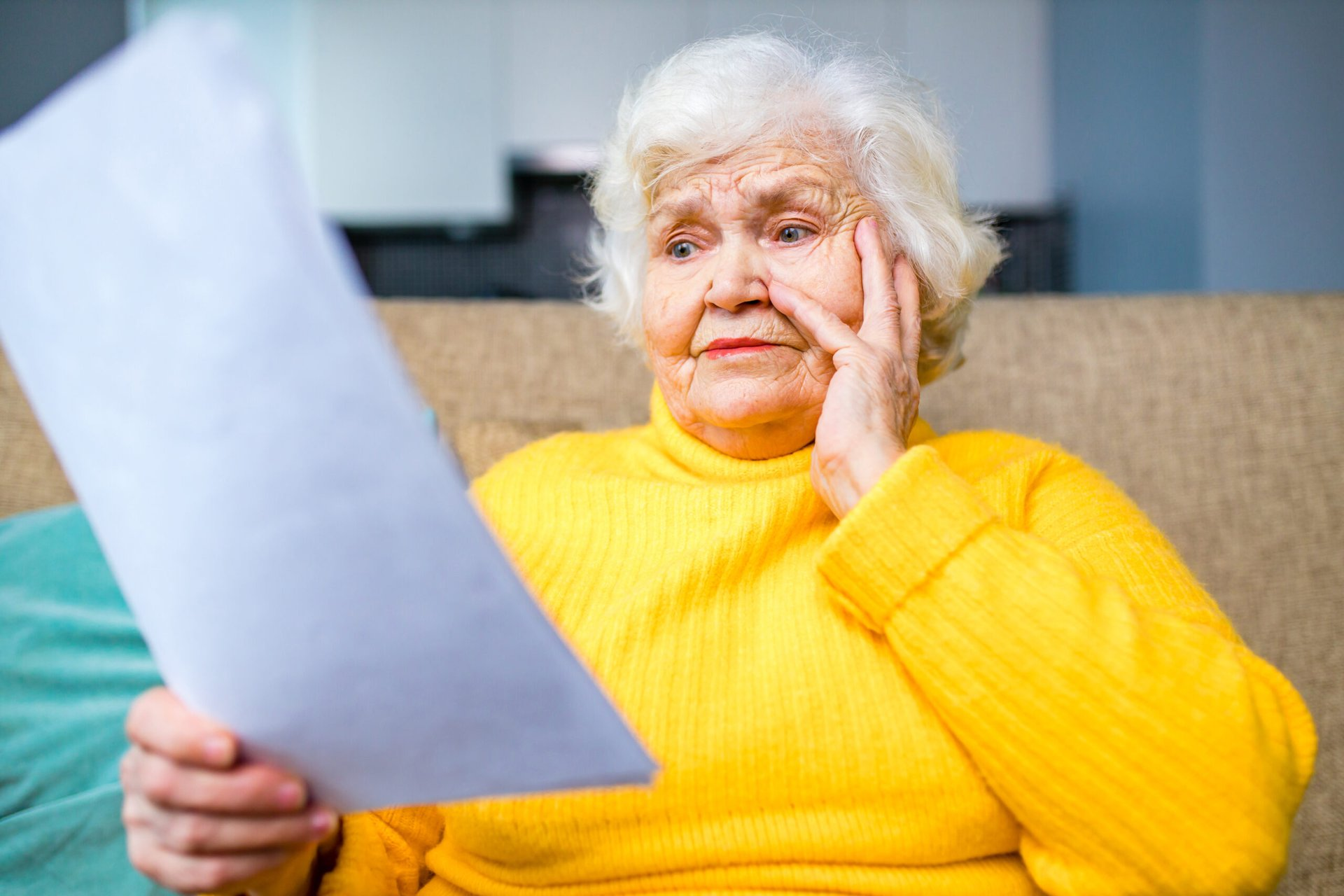 Upset senior worrying over a document