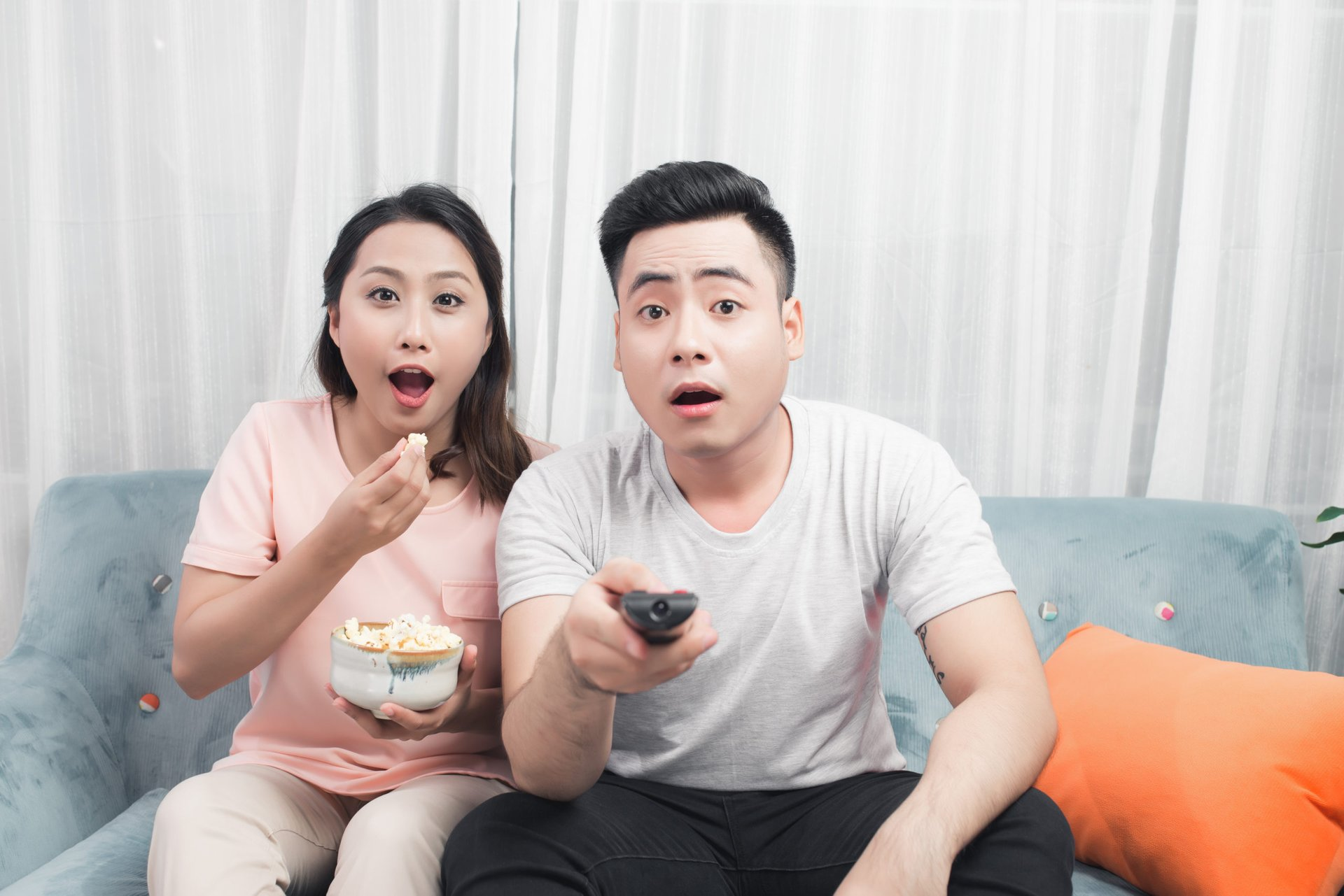 Unhappy couple watching TV