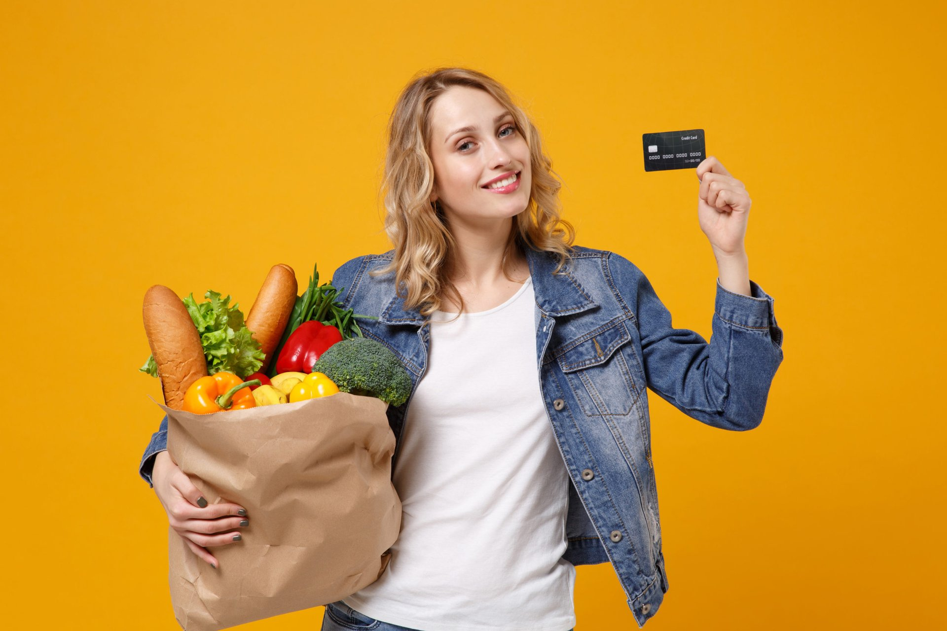 Woman excited about her groceries and credit card rewards