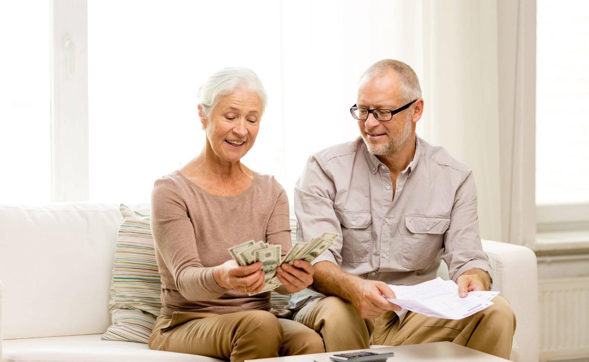 Happy seniors with money