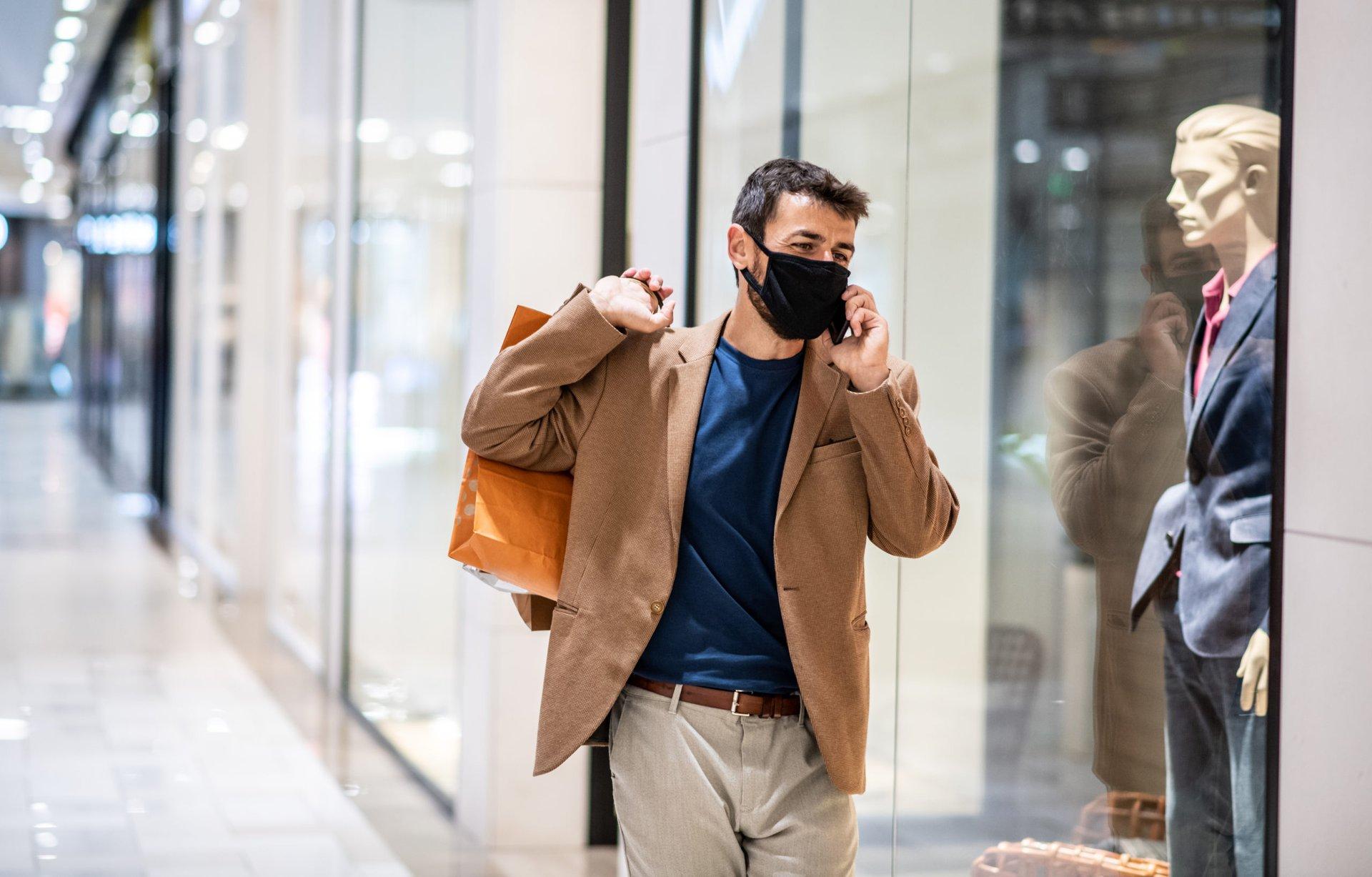 Man avoiding crowds while shopping