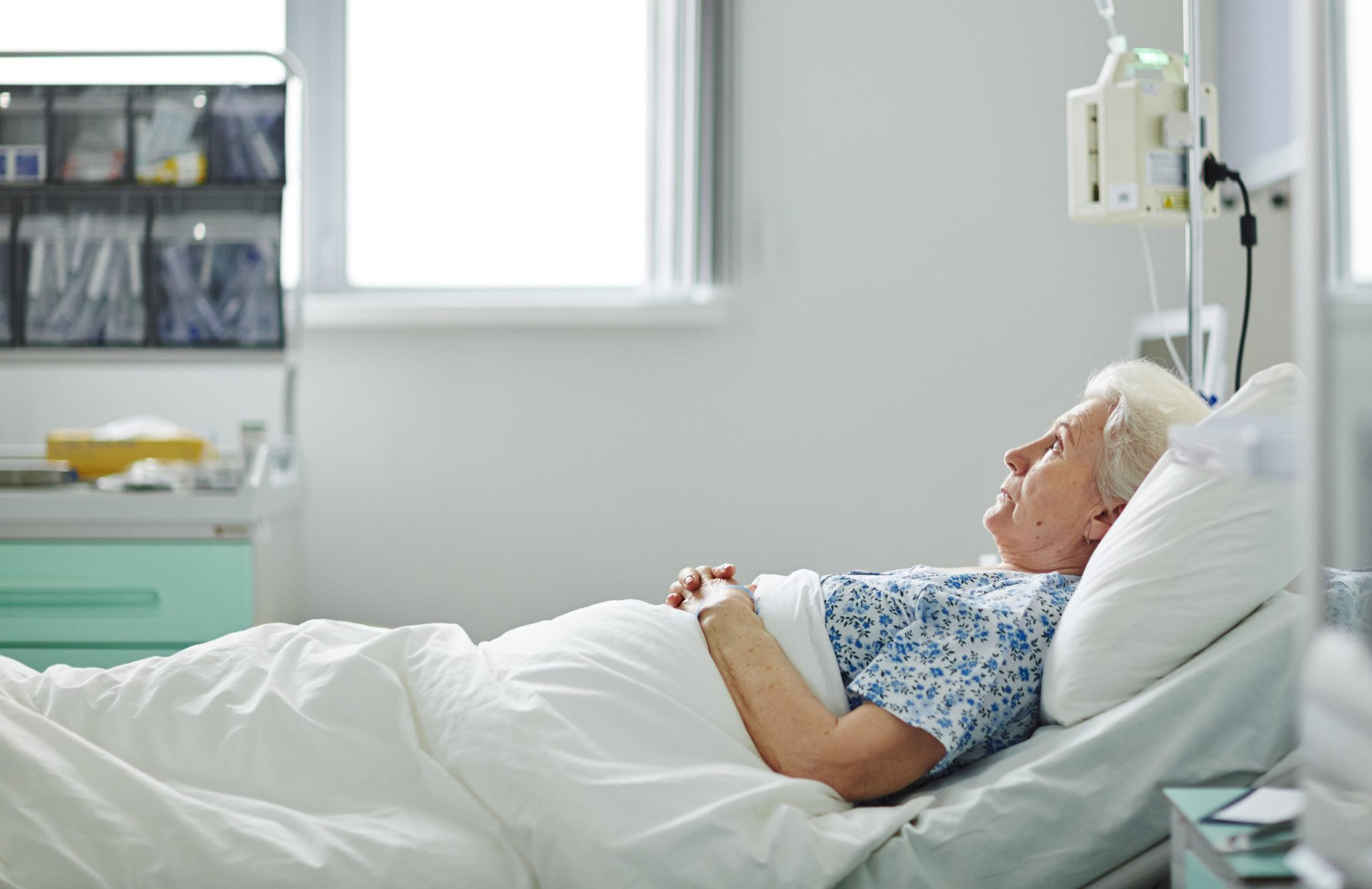 Senior lying in a hospital bed