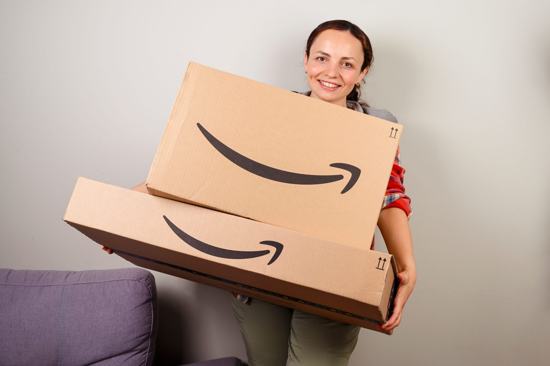 Woman holding Amazon packages