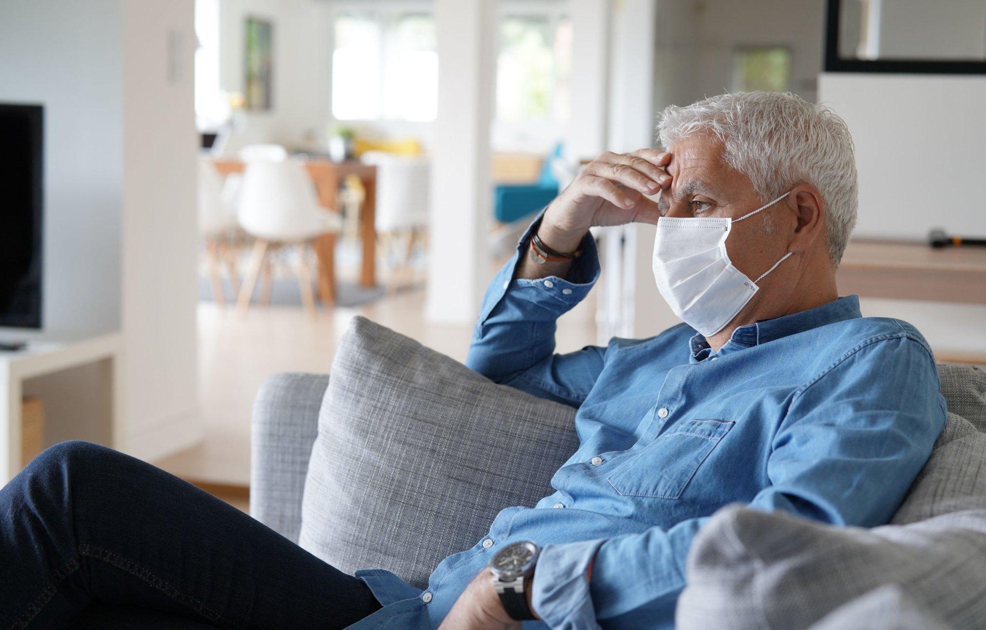 Sick senior man wearing a mask