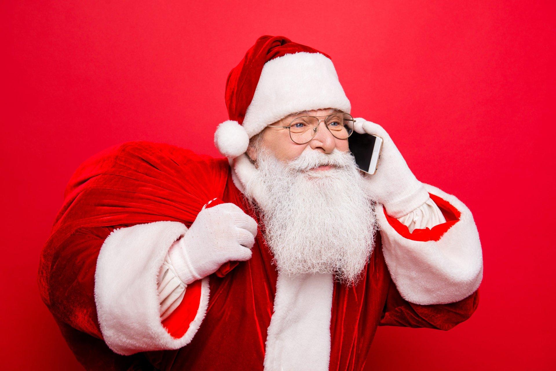 Santa talking on his smartphone