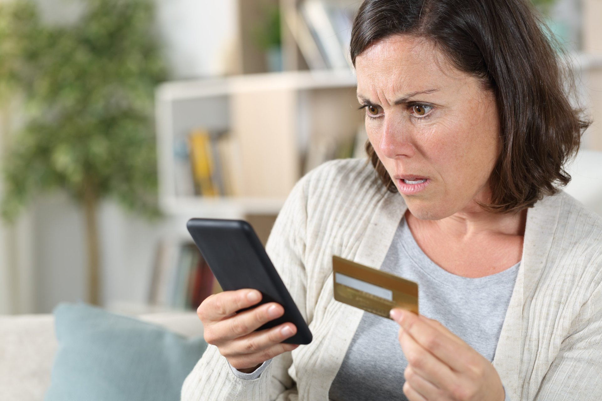 Upset woman with gift card