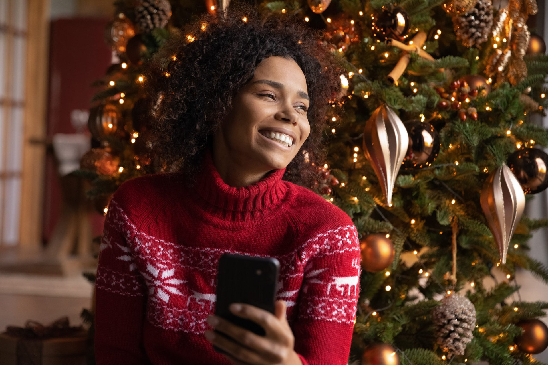 Woman happy with her new phone on Christmas