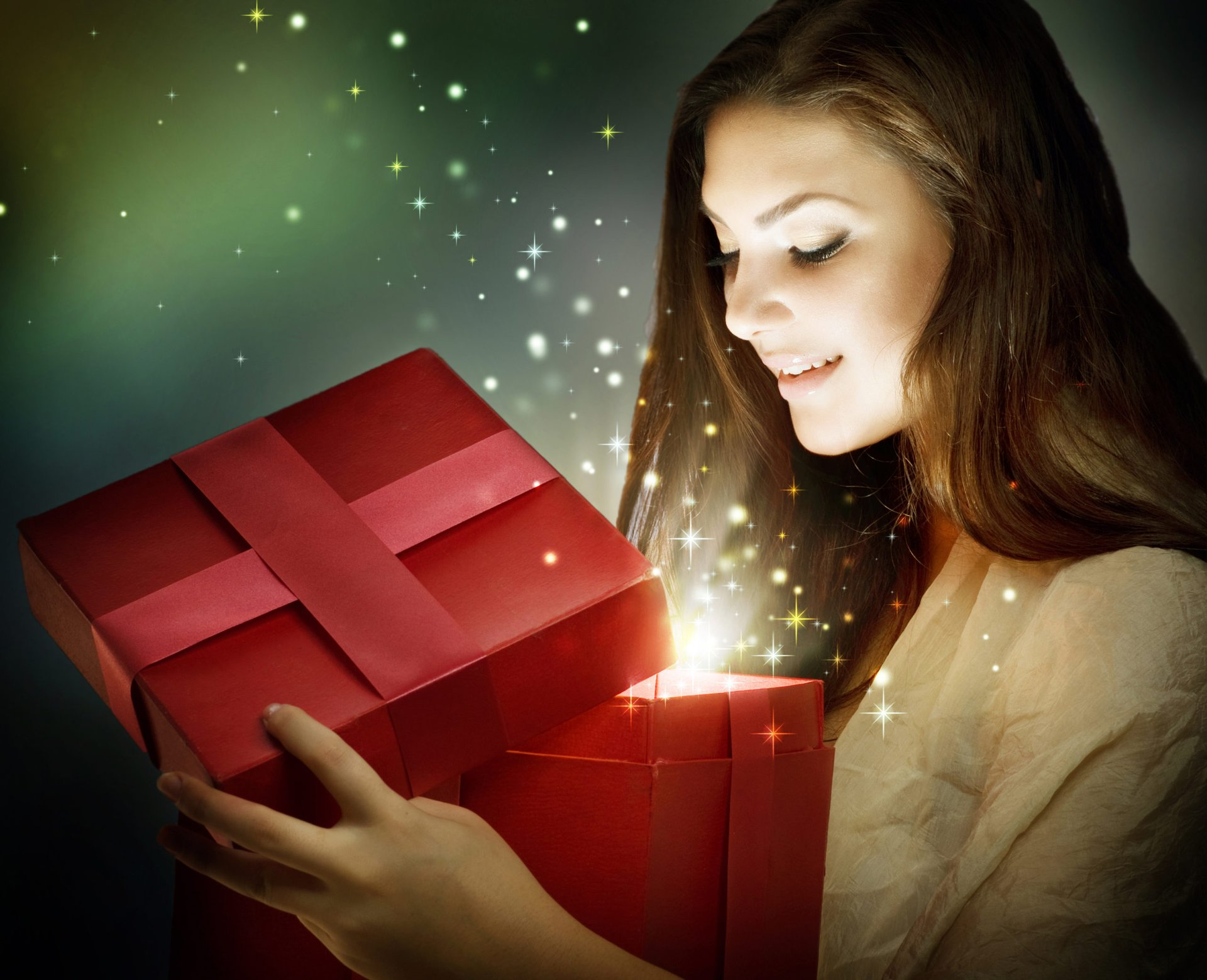 A woman opens a magical holiday gift