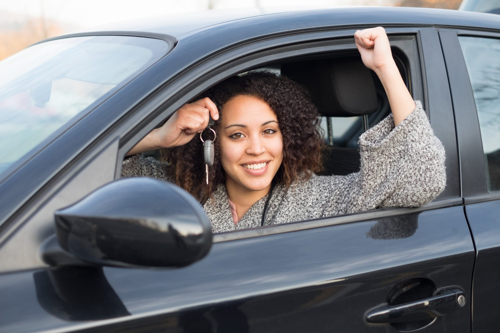 A driver holds the keys to her used car