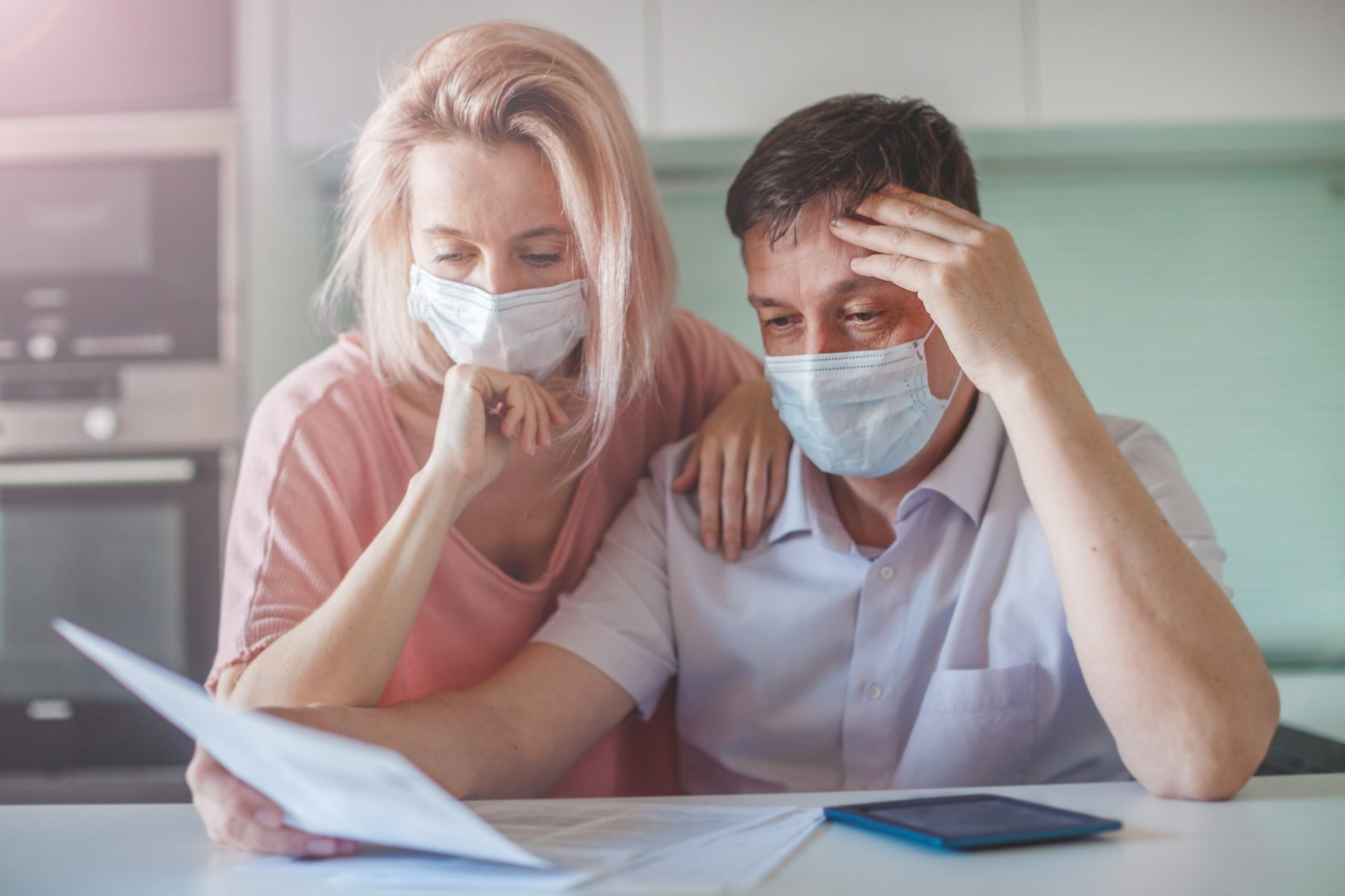 Couple in mask worrying about their finances