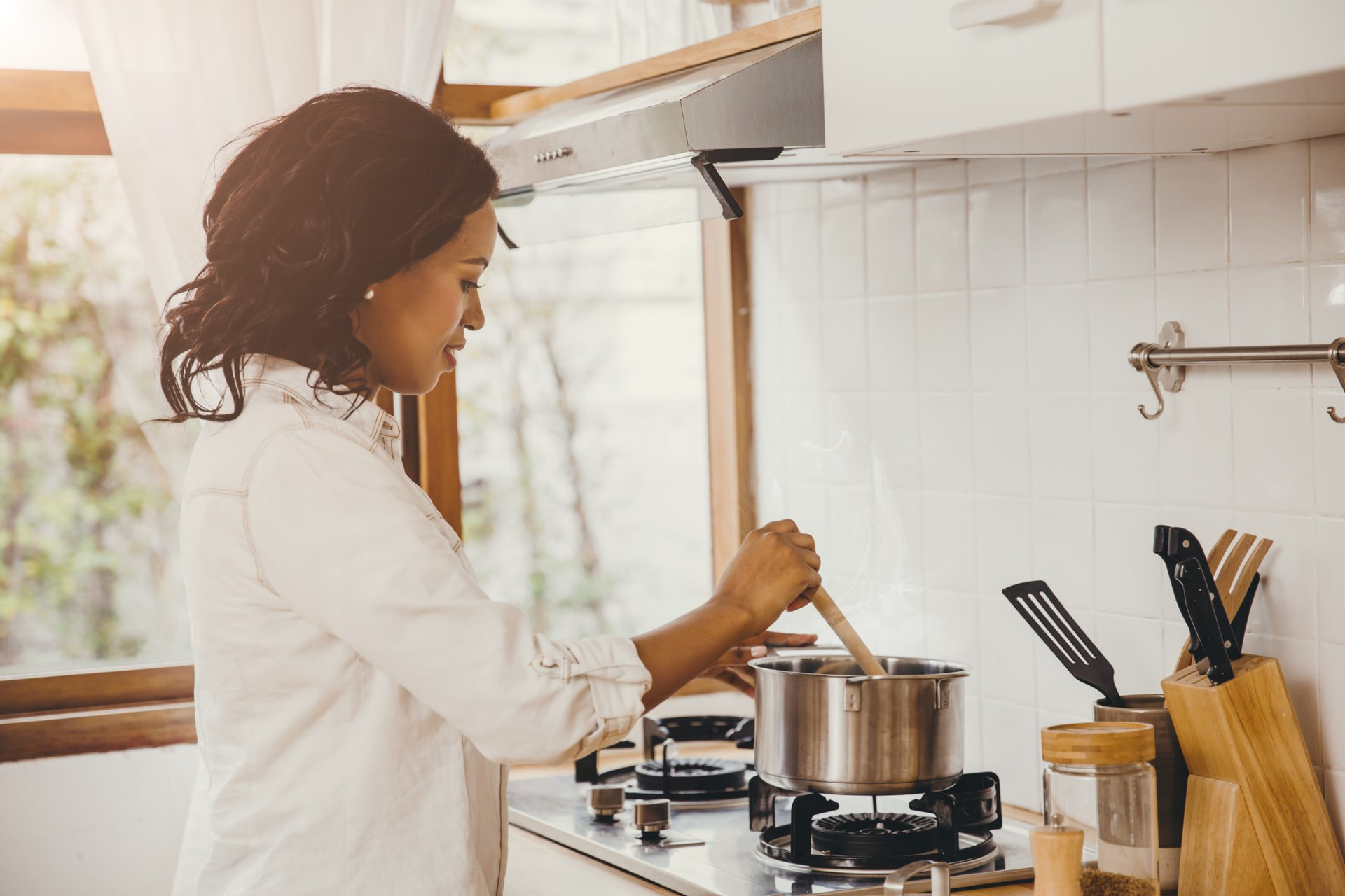 Woman cooking food on her stove