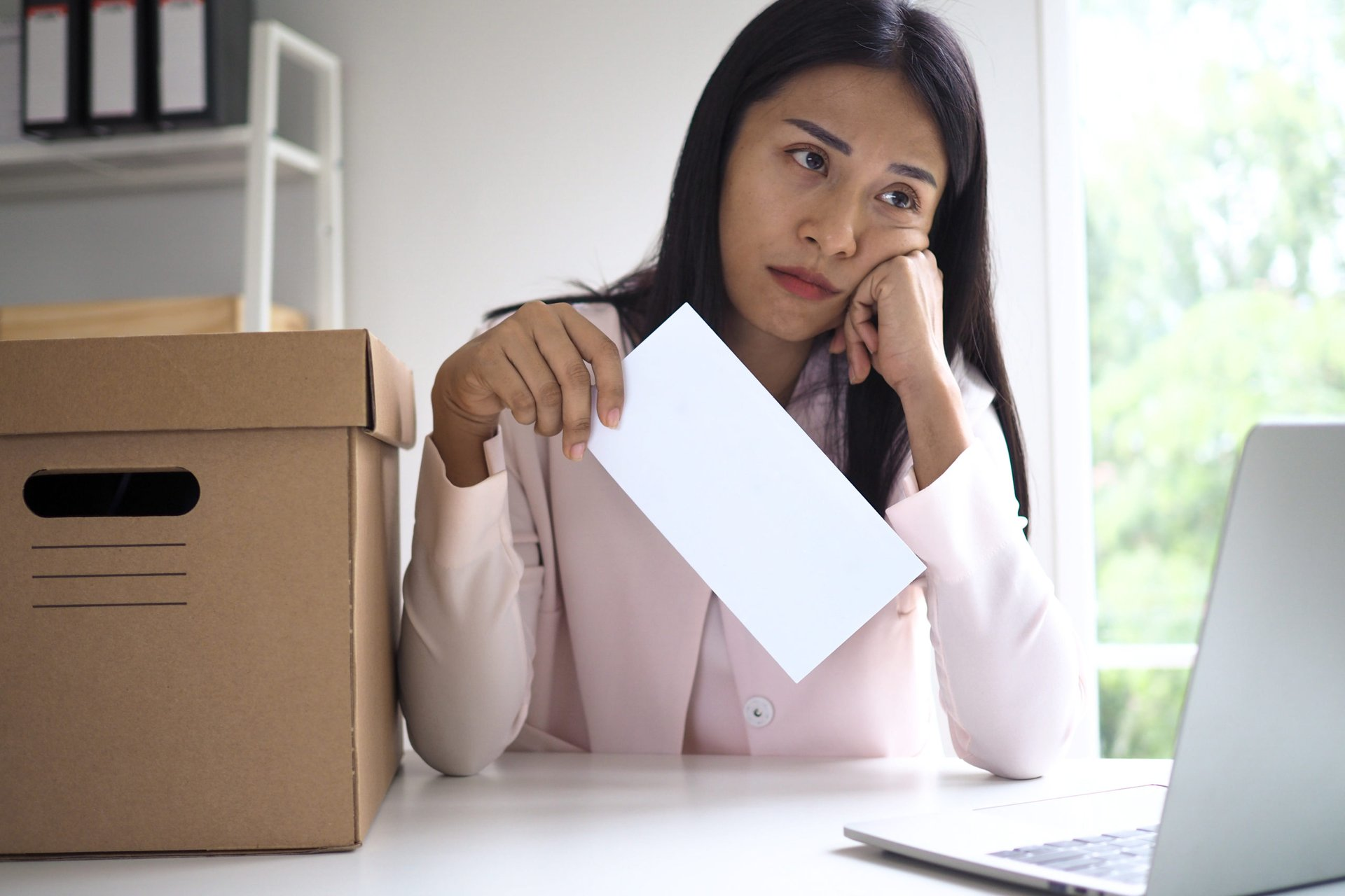 Unhappy woman with envelope