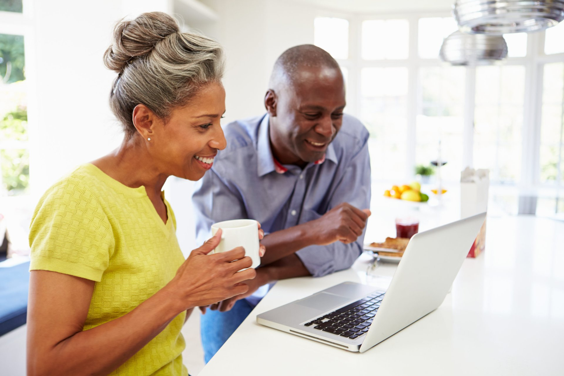 Middle-aged couple at a computer
