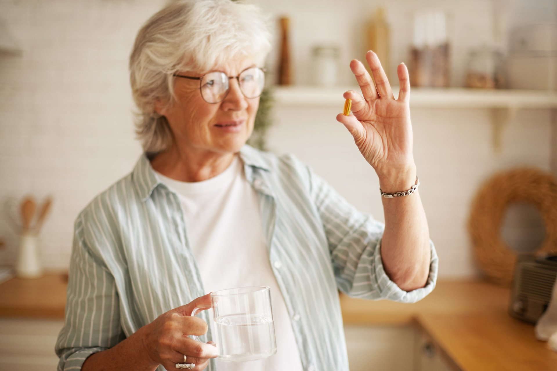 Woman holding a multivitamin