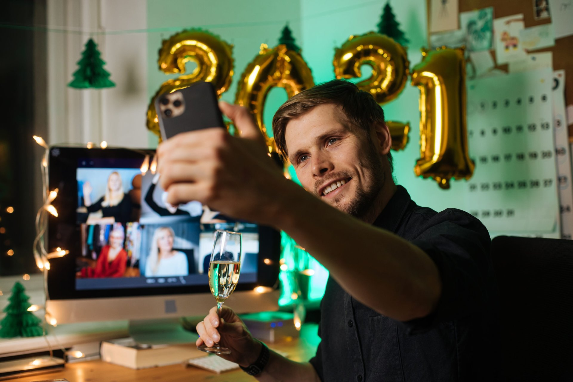 Man using his phone on New Year's Eve