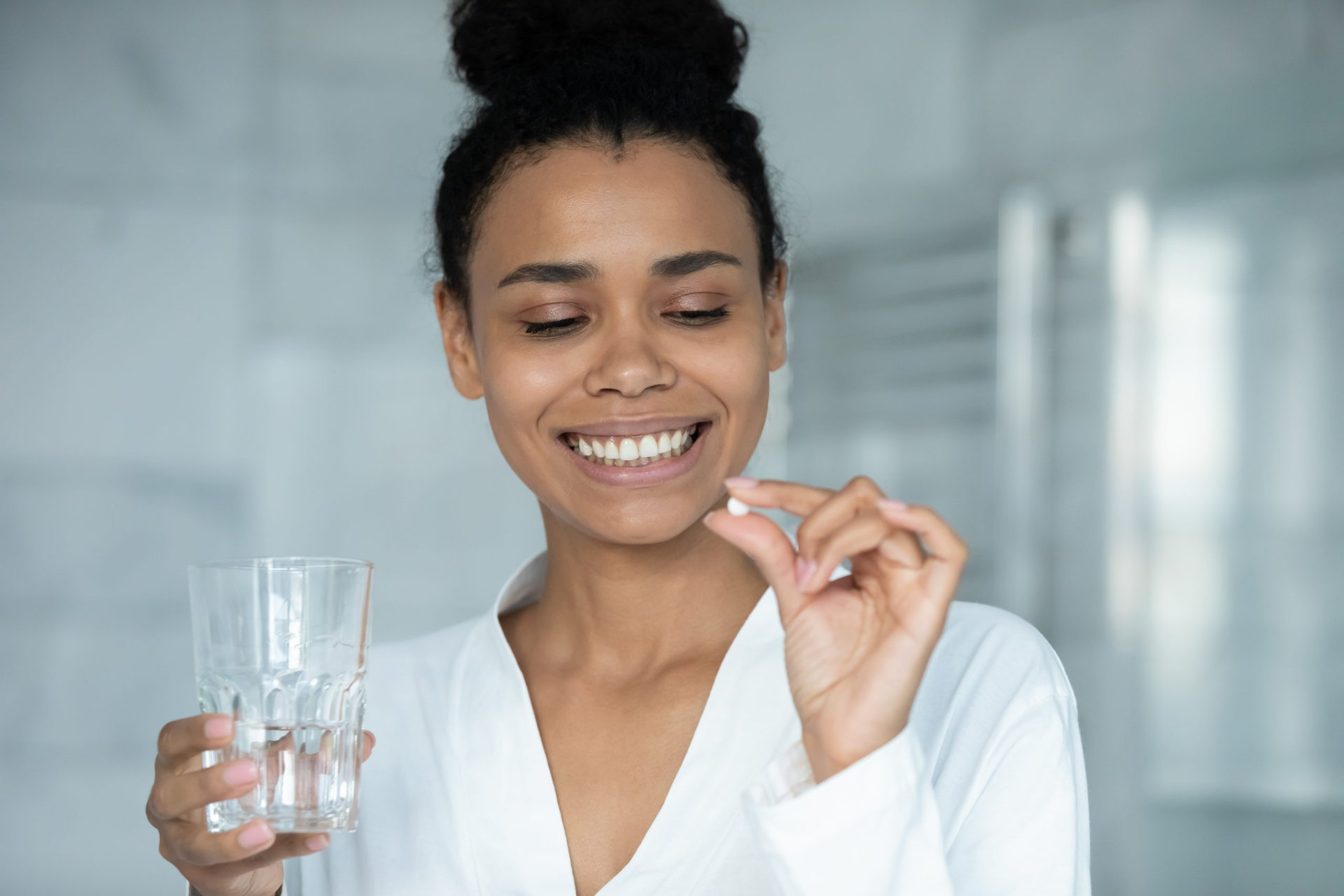 Woman taking vitamin