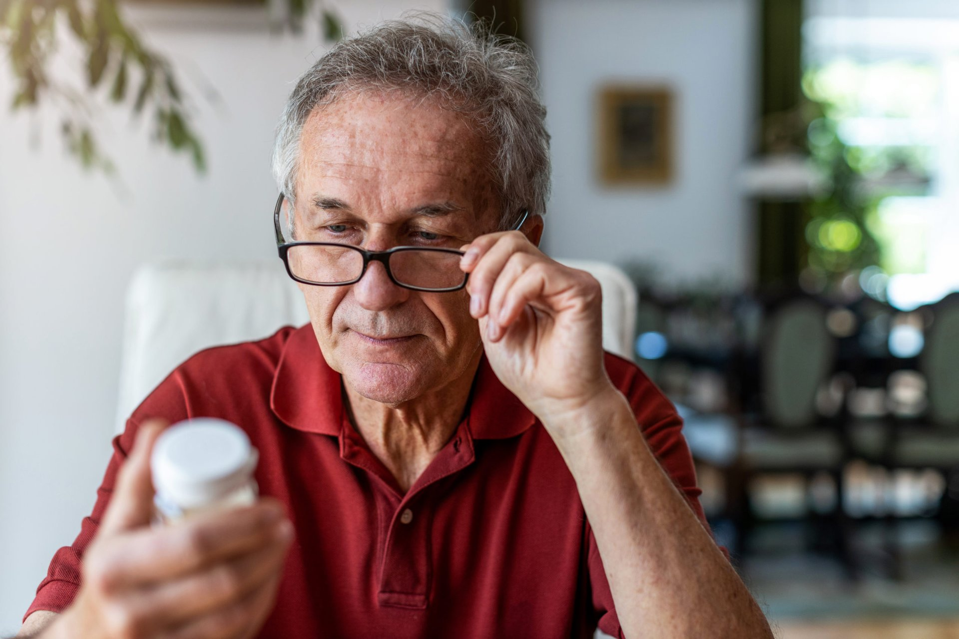Man reading a prescription drug label