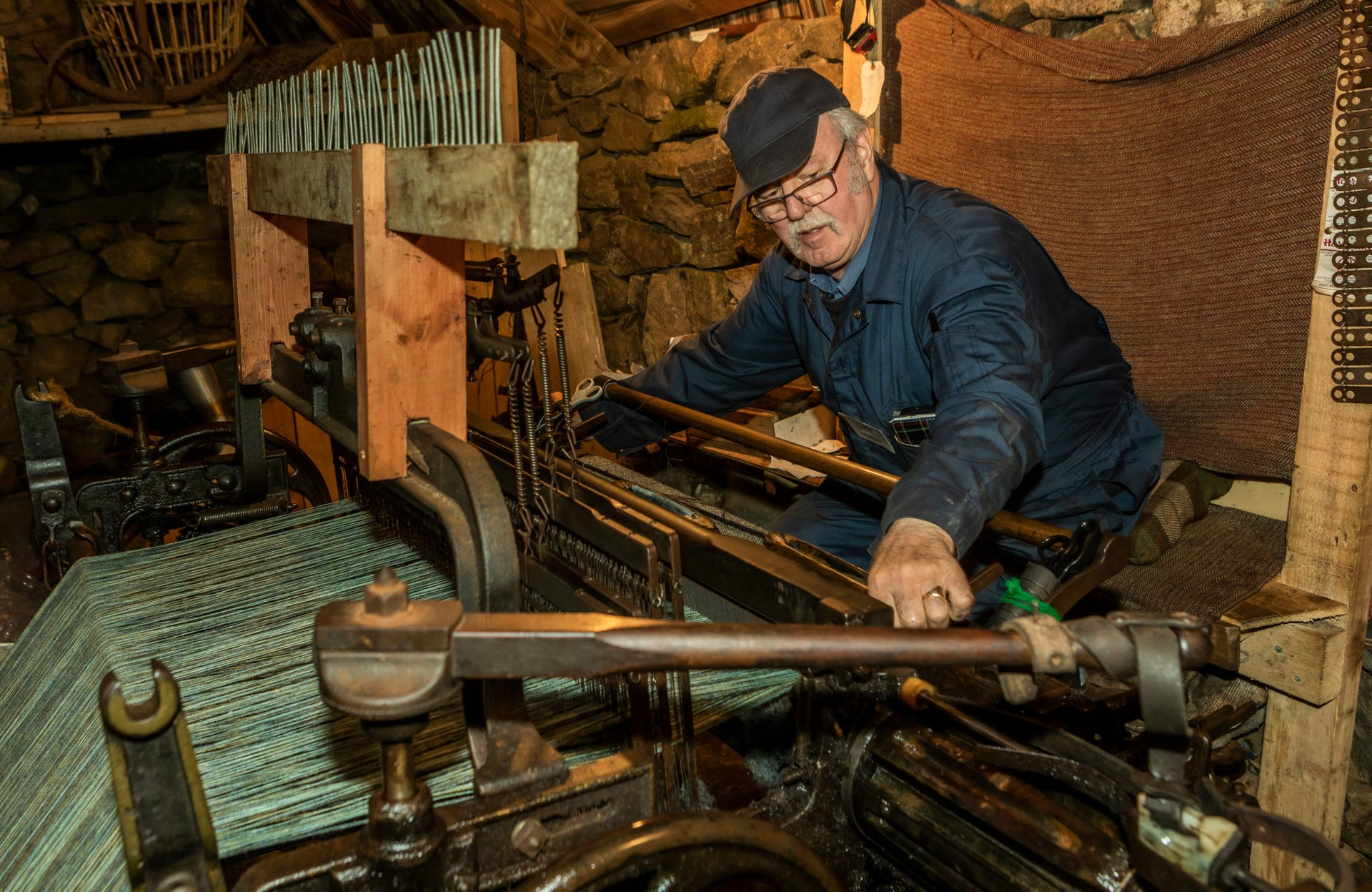 Man weaving Harris Tweed fabric