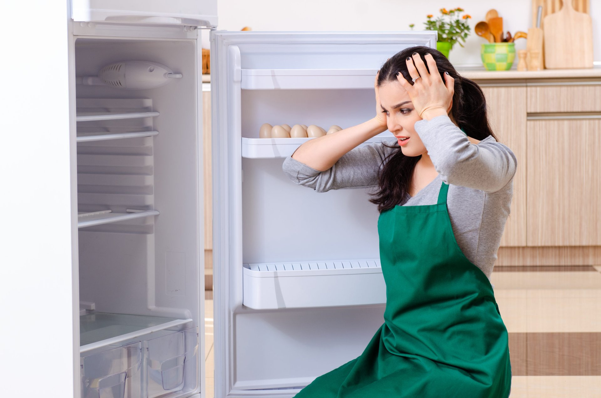 A woman is upset after damaging her fridge with vinegar