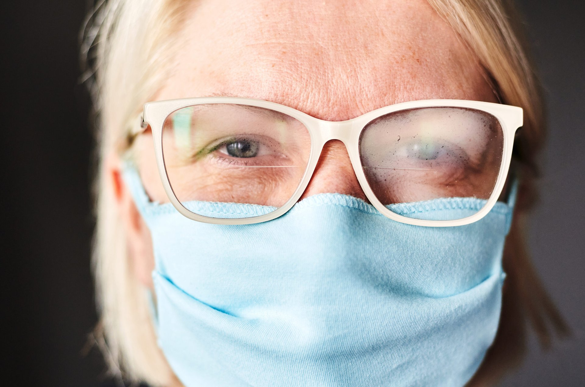 Woman wearing eyeglasses over a mask