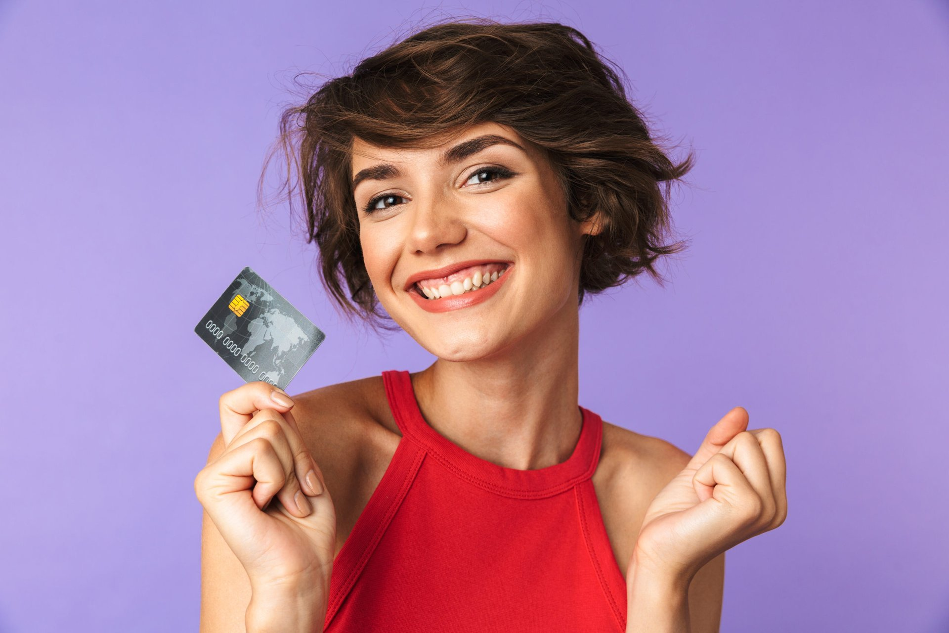 Smiling woman excited about her new credit card