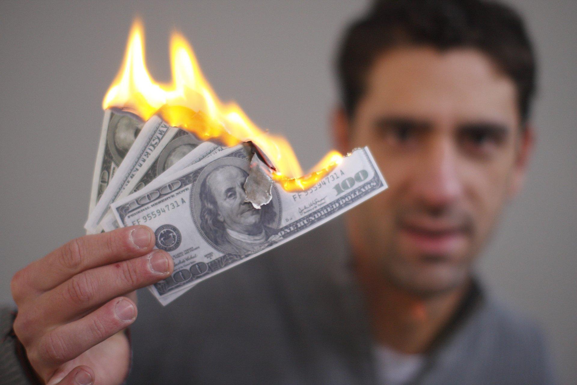Man burning cash