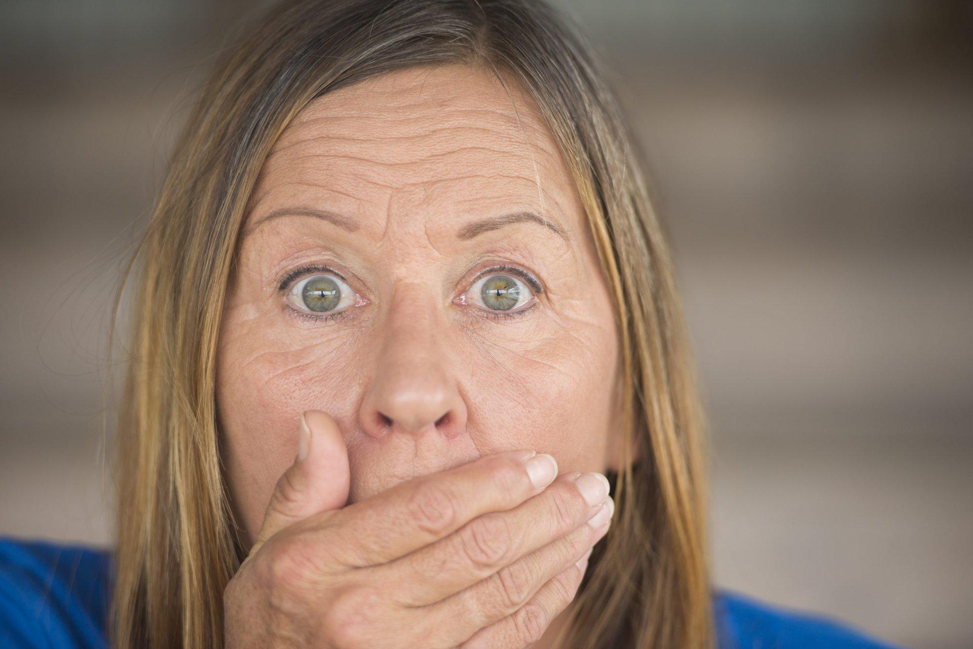 Surprised older woman in shock