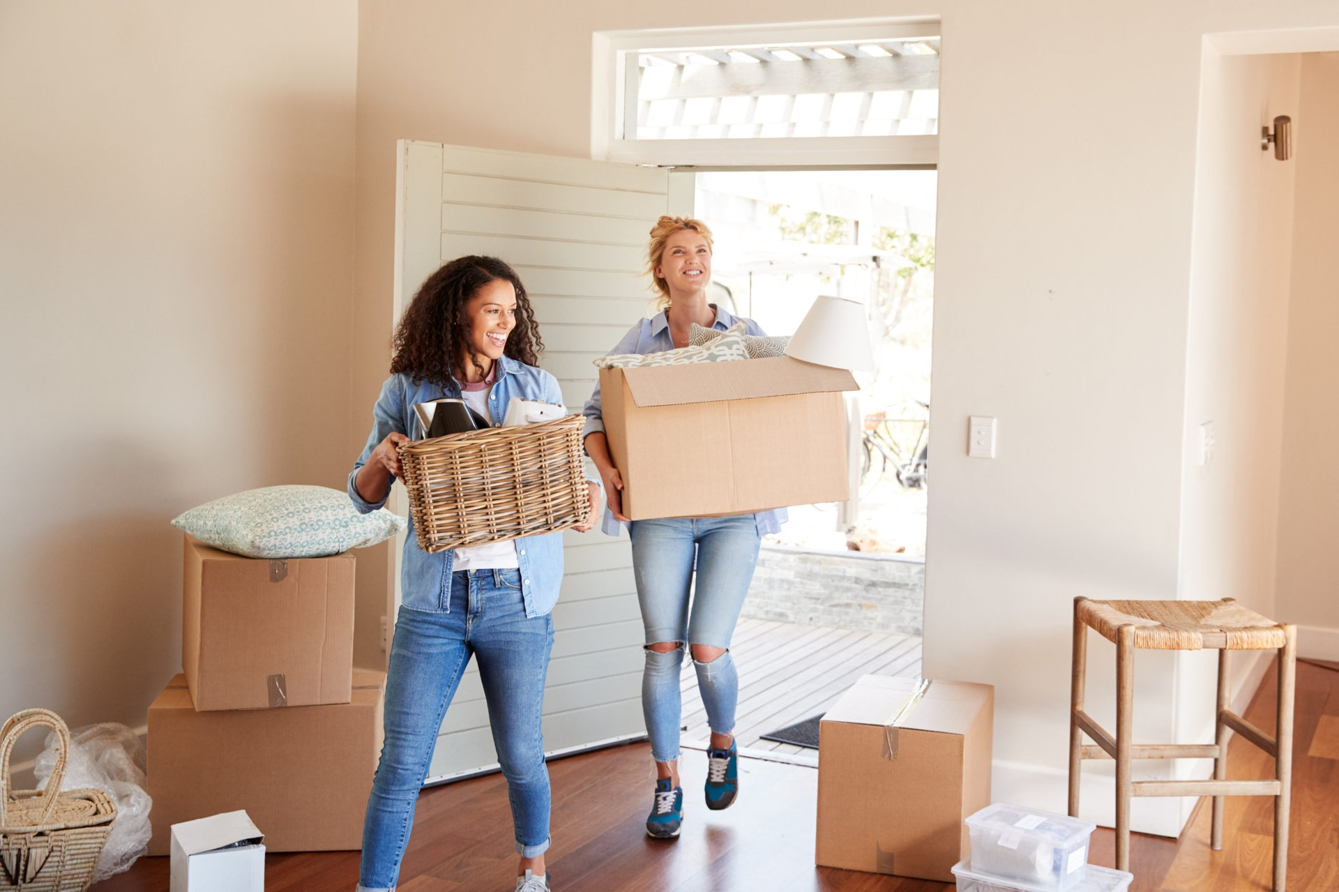 Women carrying moving boxes