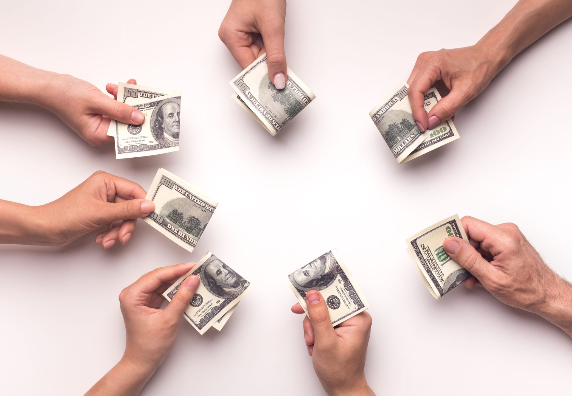 Crowdfunding hands with money