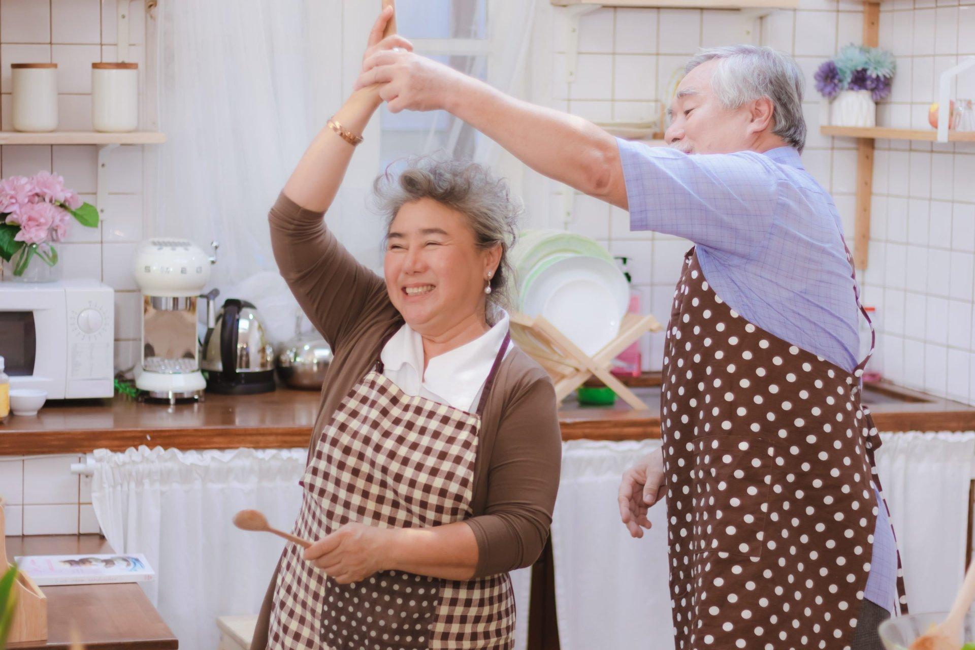 Happy senior couple in the kitchen