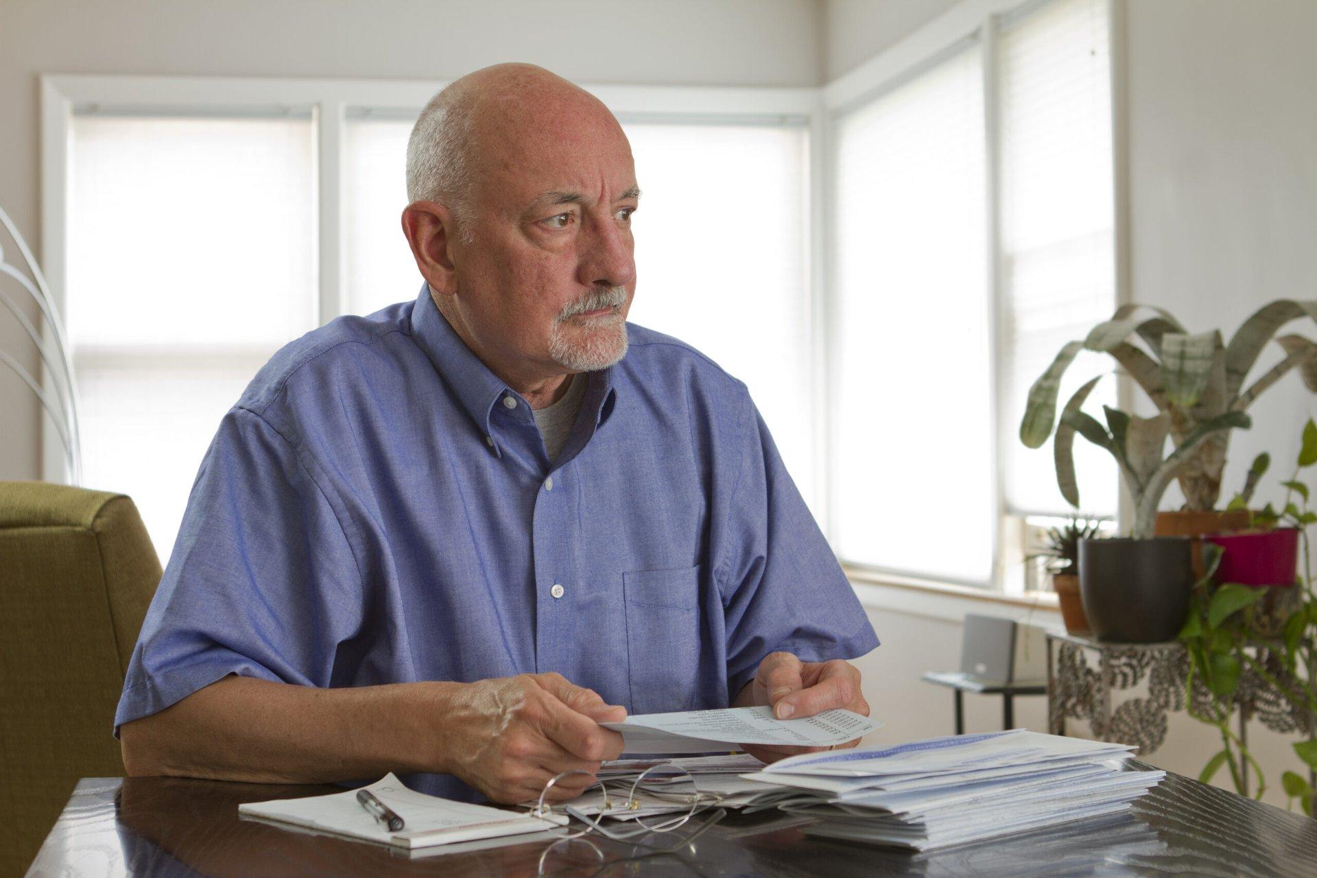 Worried senior paying bills