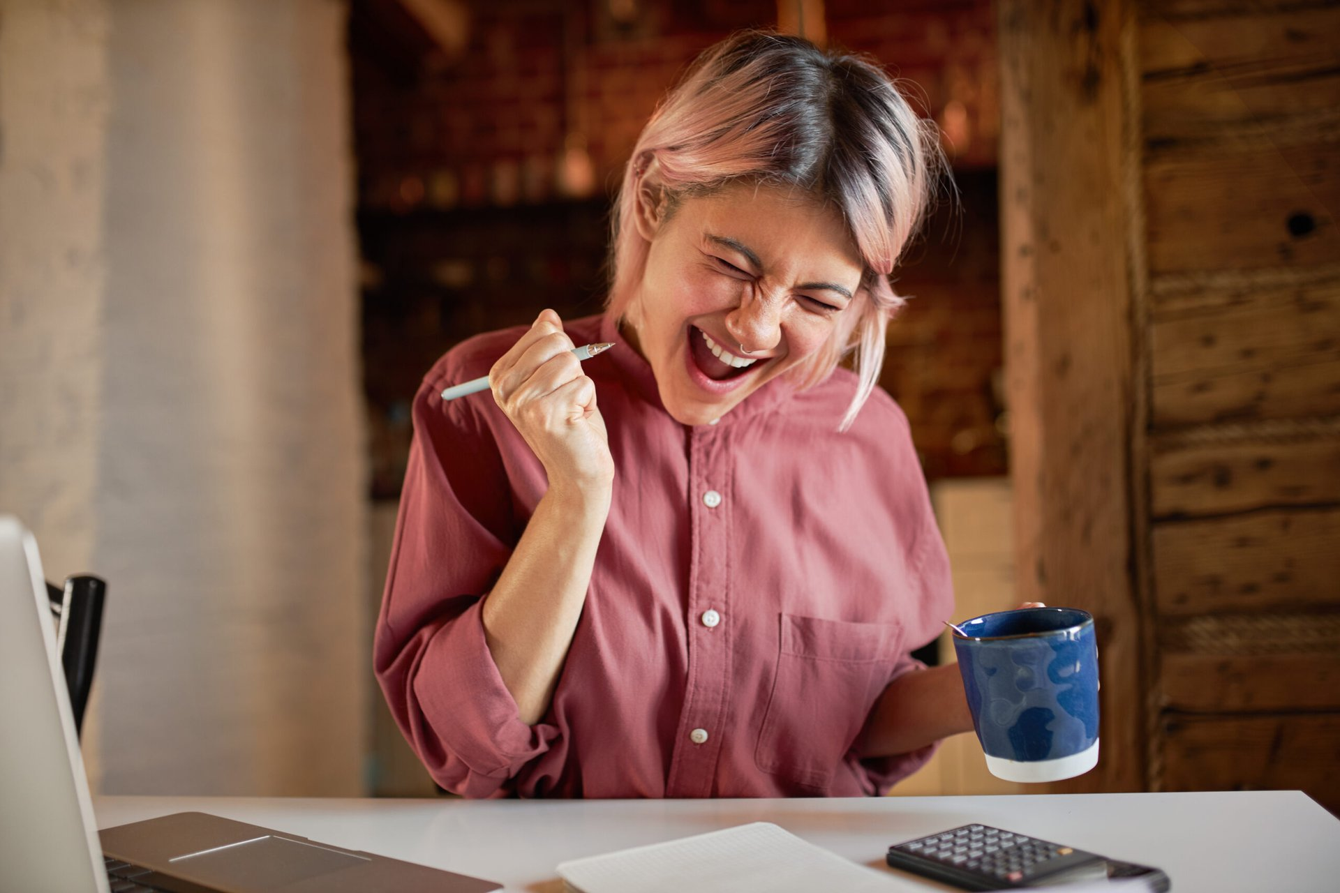 Excited woman working on taxes
