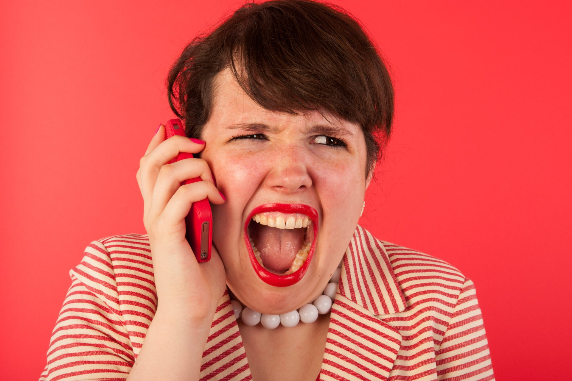 Angry woman on her phone