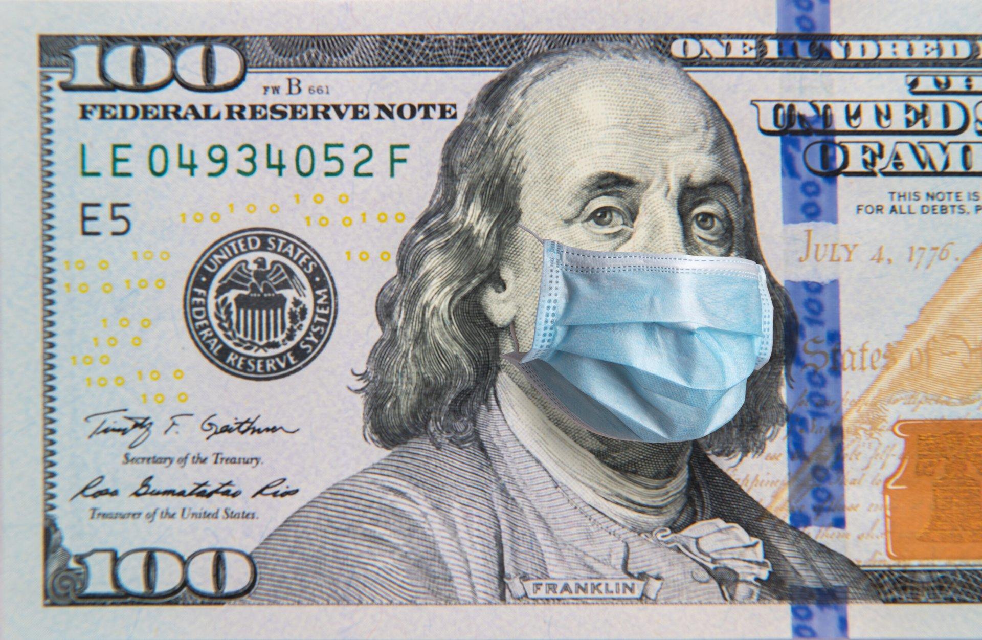Benjamin Franklin in a mask on a $100 bill