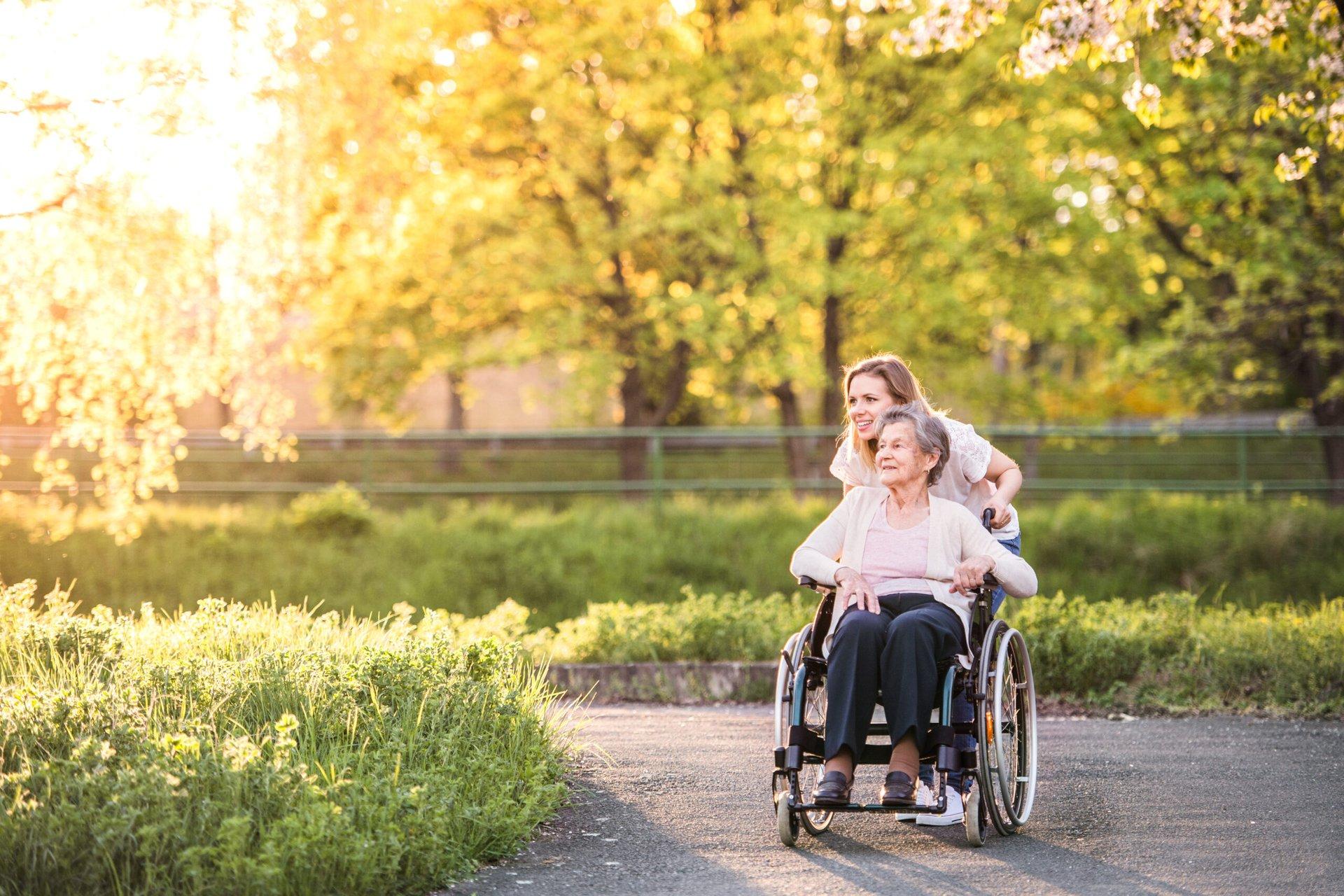 Senior in a wheelchair enjoying the outdoors