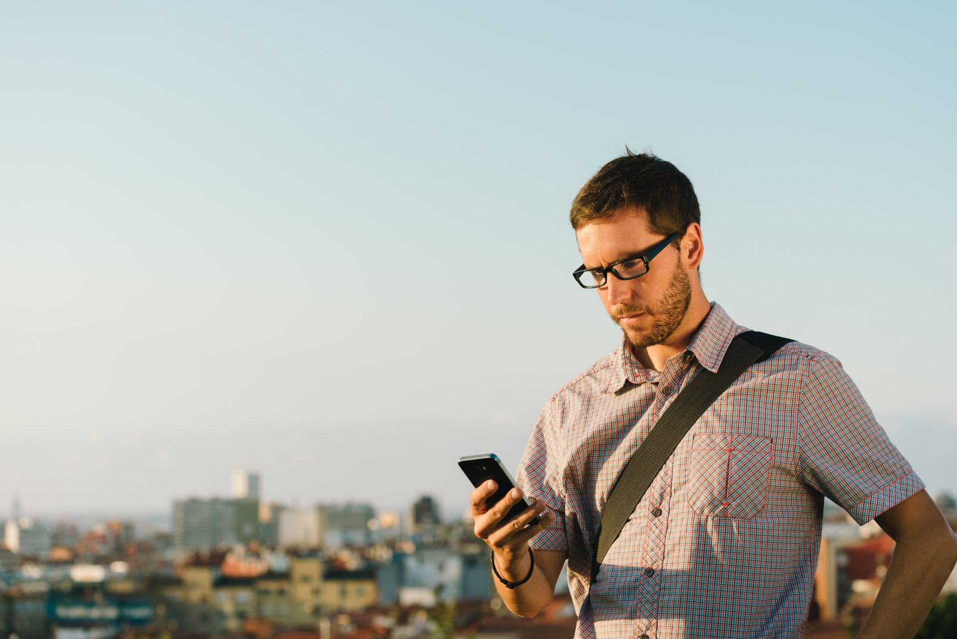 Man using his phone outdoors
