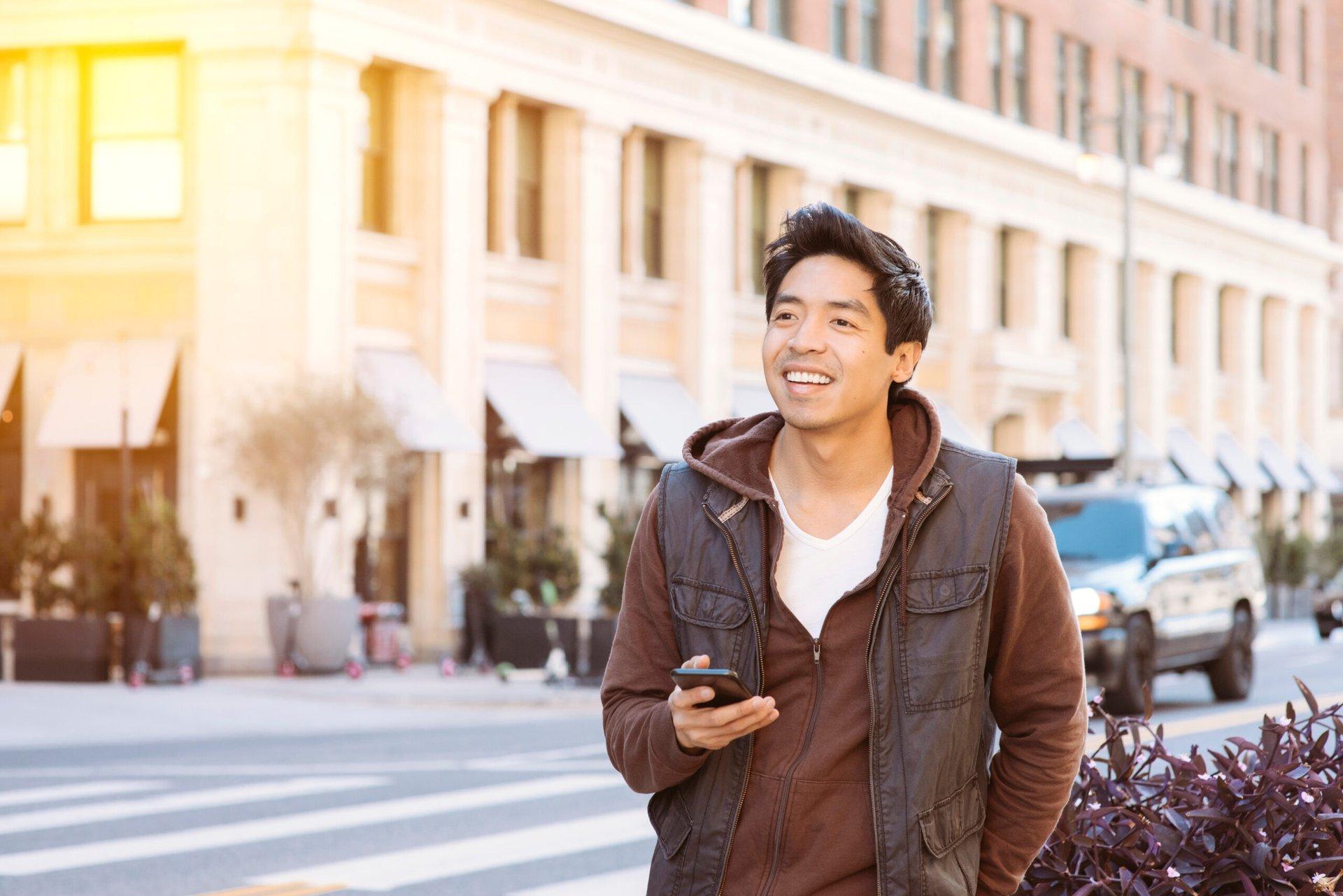 Man using phone to schedule Lyft ride