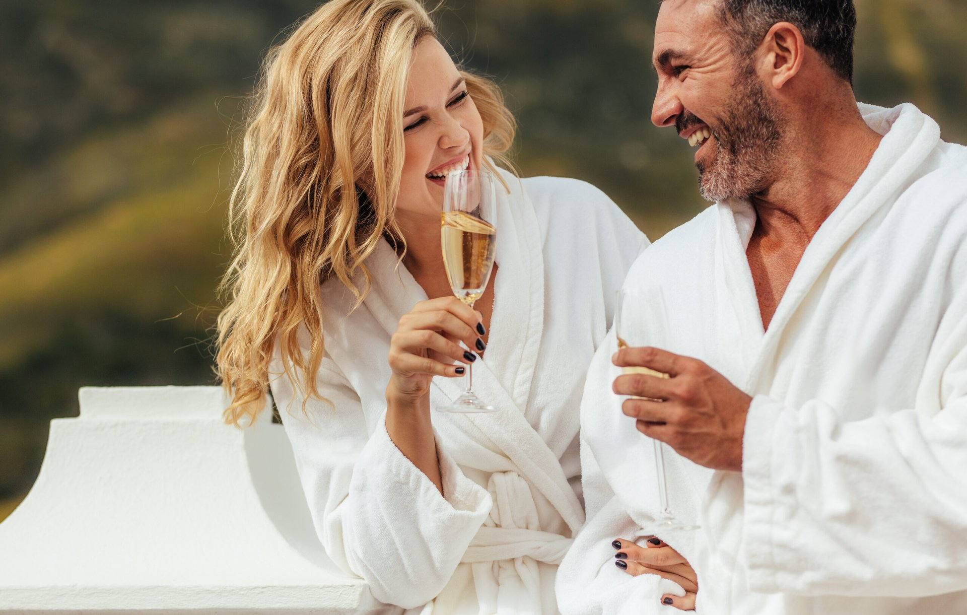 Couple drinking champagne in bathrobes