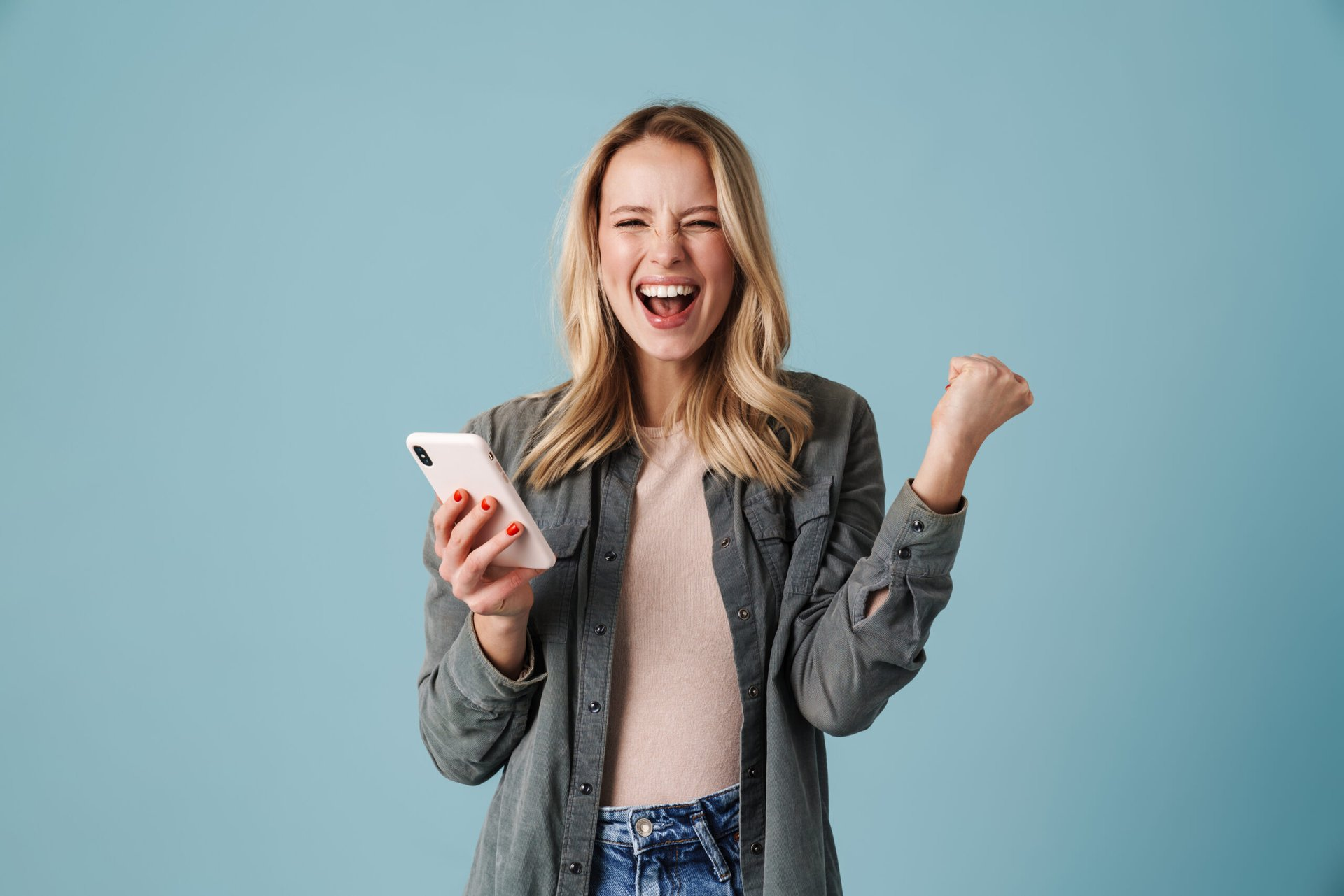 Woman excited with new phone