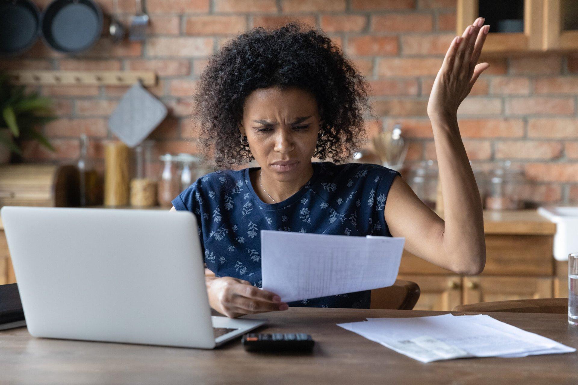 Unhappy woman reading a bill