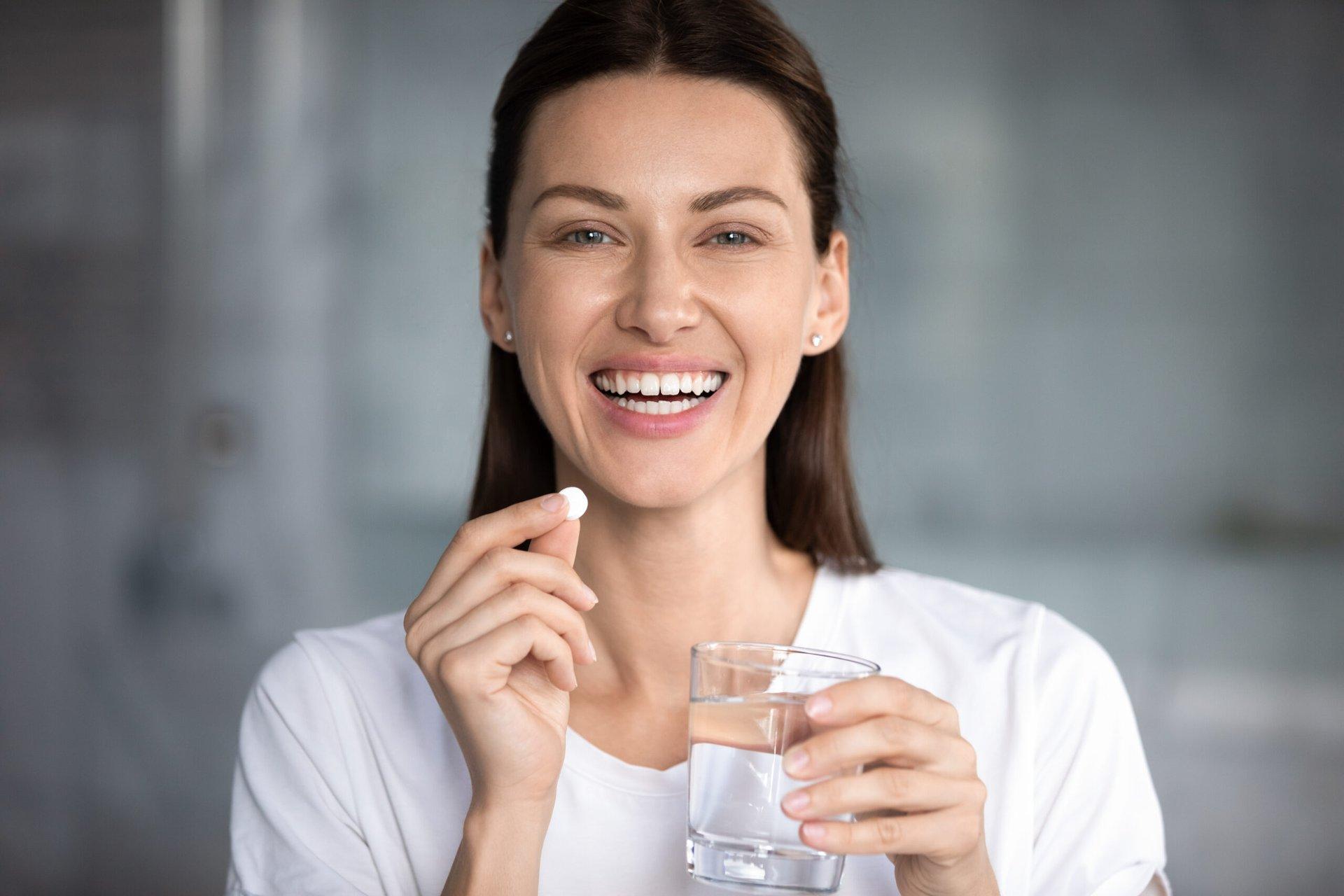 Woman taking a medication