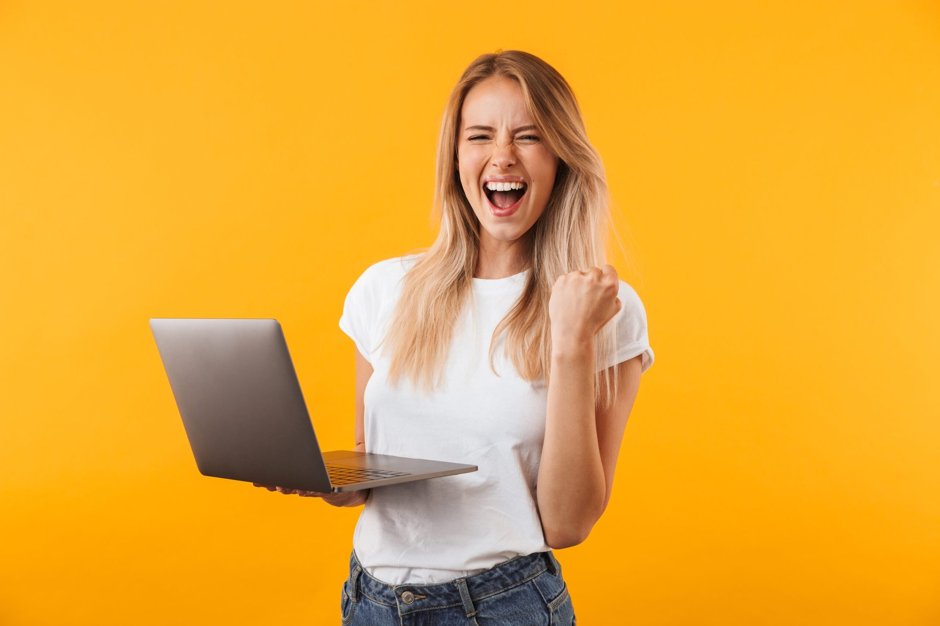 Excited woman on a laptop