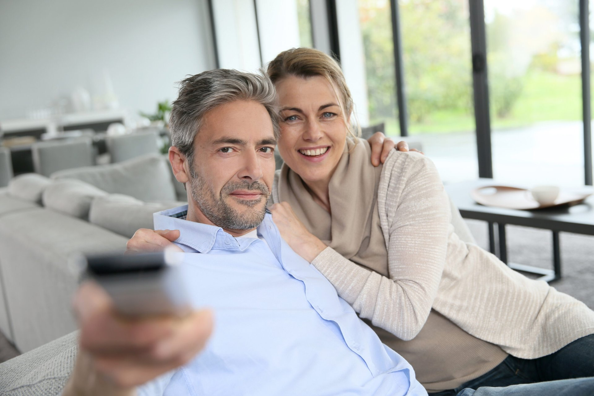 Middle-aged couple watching TV