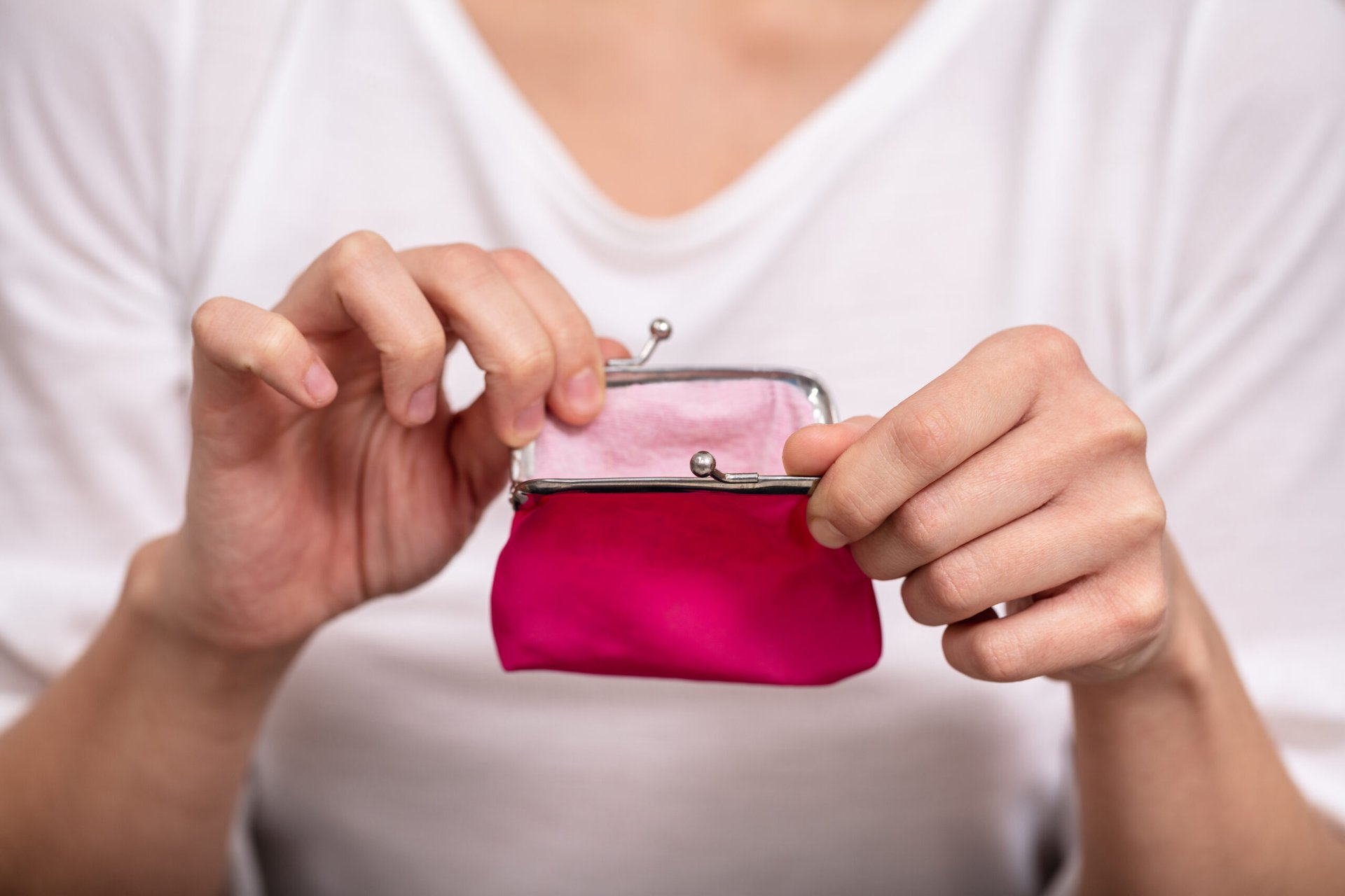 Woman opening a coin purse