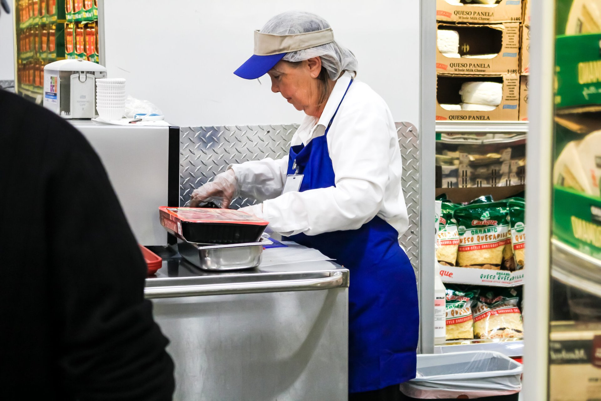 A woman providing food samples Costco