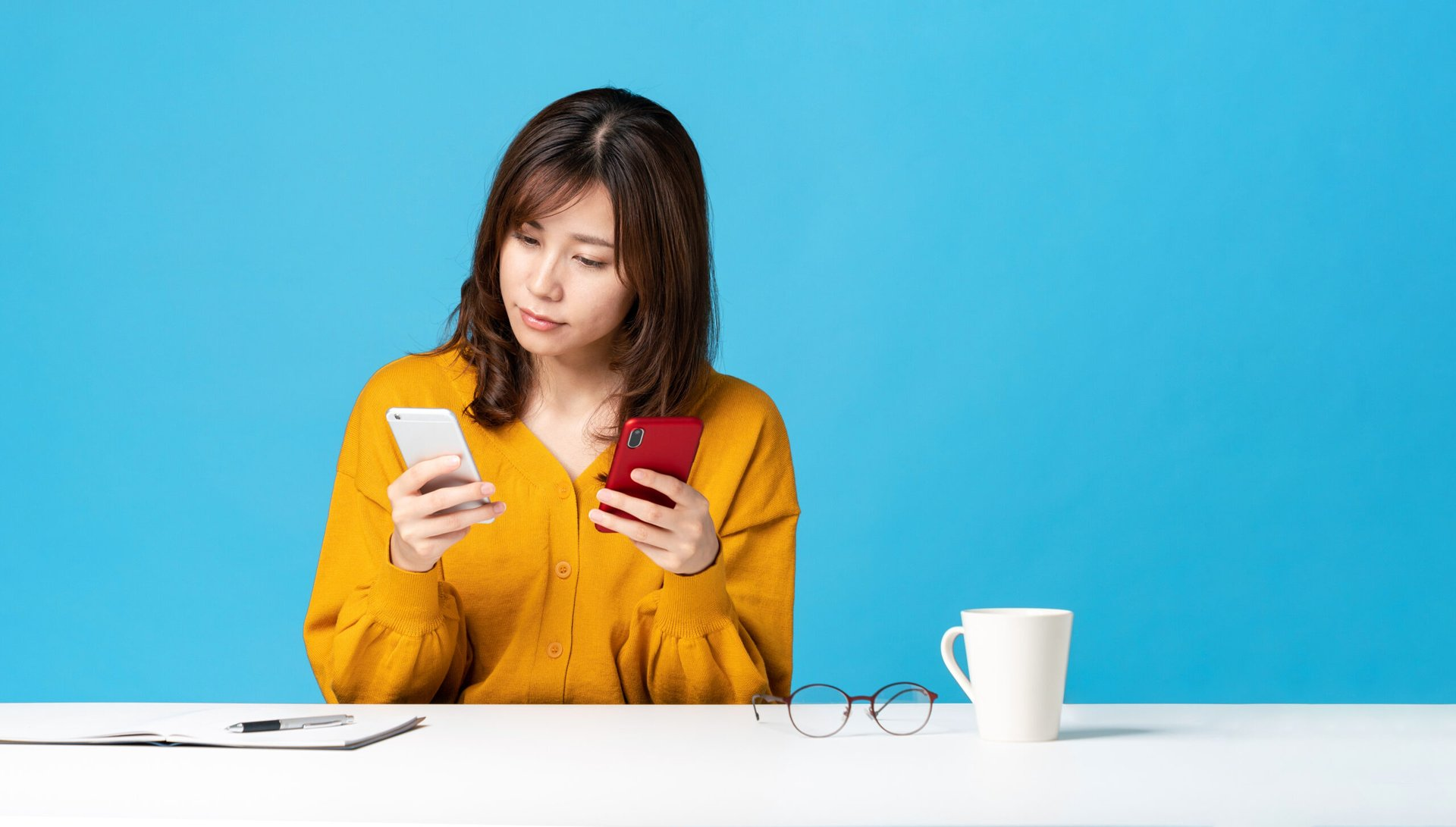 Woman comparing two phones or cellphone plans