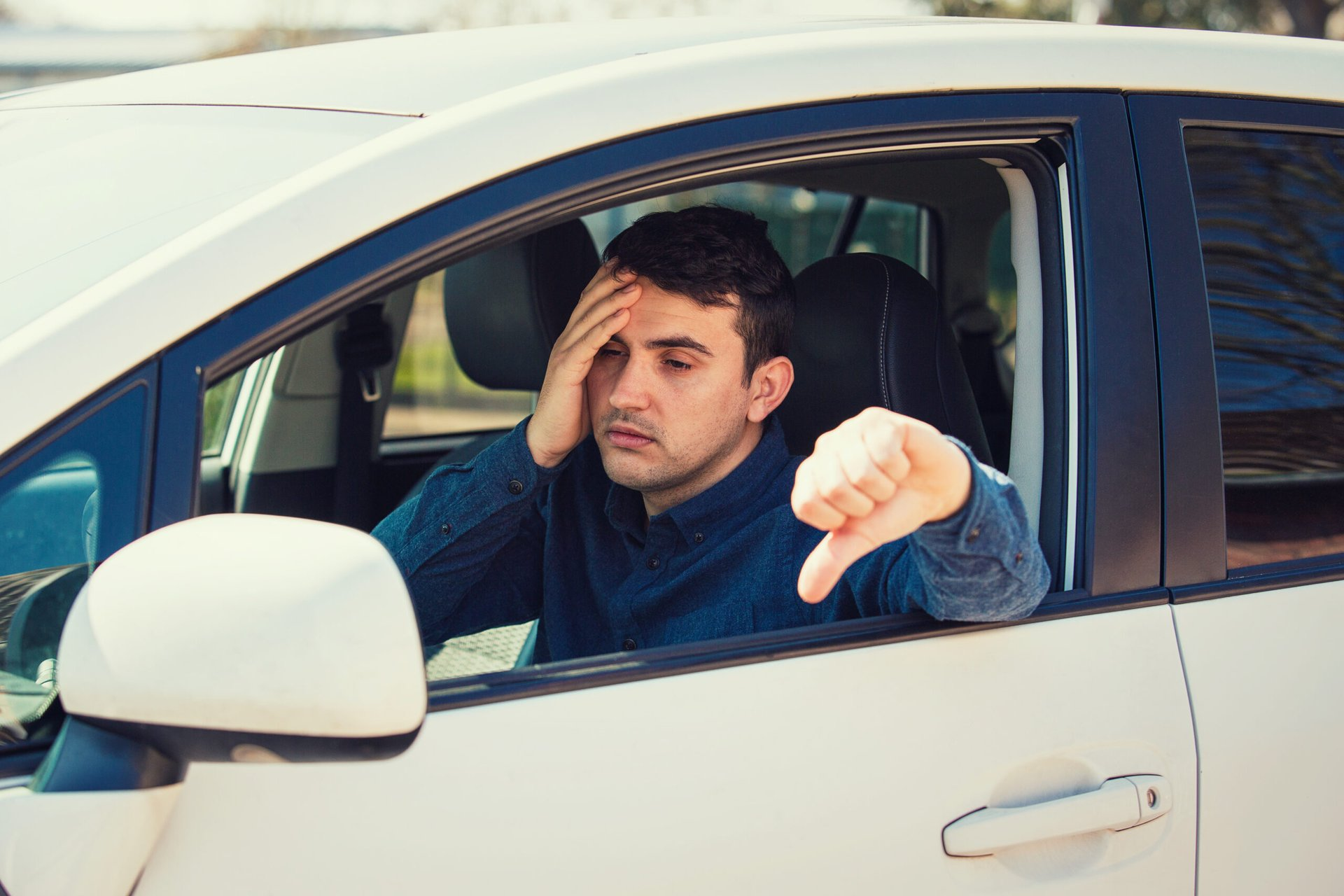 Unhappy driver with thumbs down