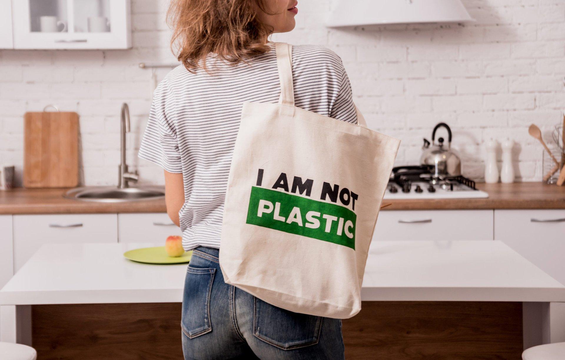 Woman carrying a reusable shopping bag
