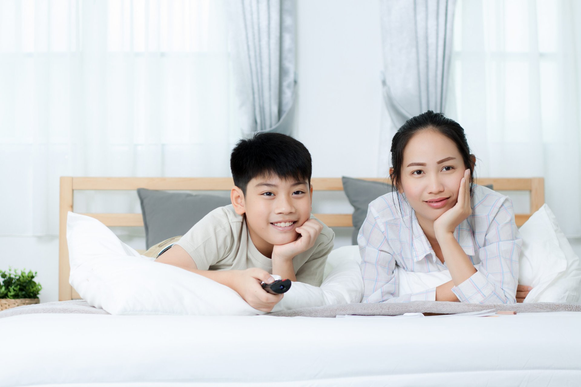 Mom and her son watching TV